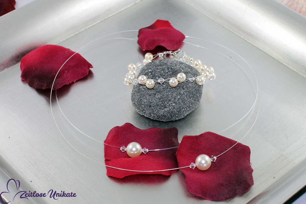 Einzelne Perle und Kristalle