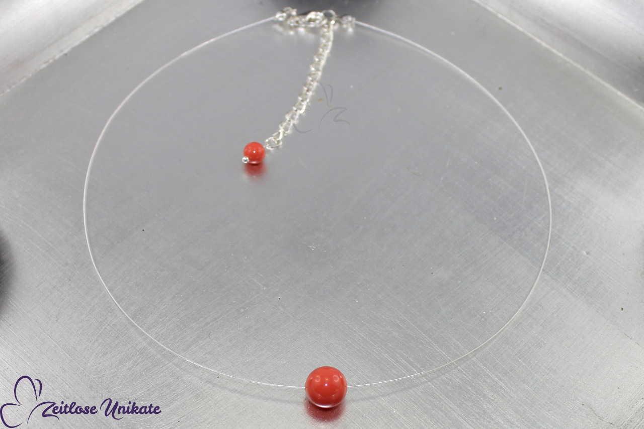 durchsichtige Kette eine Perle in coral