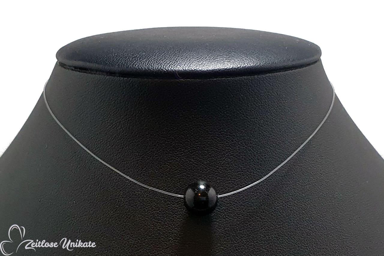 fliegende Perle, eine schlichte schwarze Kette