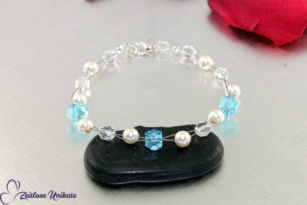 Hochzeitsarmkette blaue Perlen, Tradition