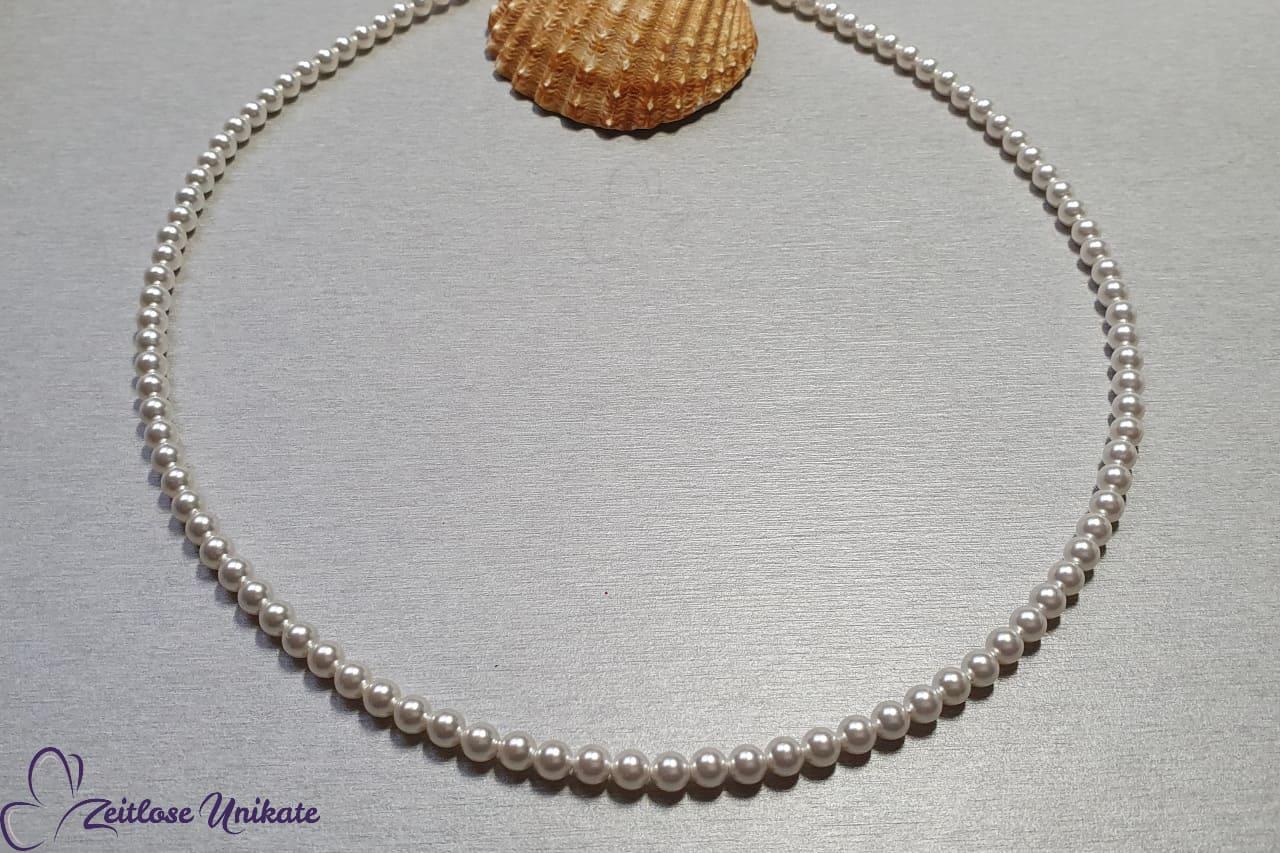 Die zierliche Perlenkette