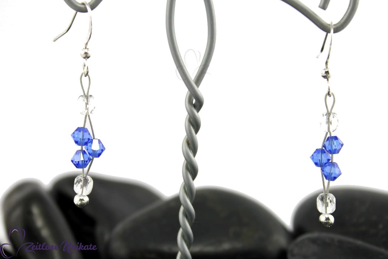 interessante elegante Ohrringe in safir blau und kristallklar