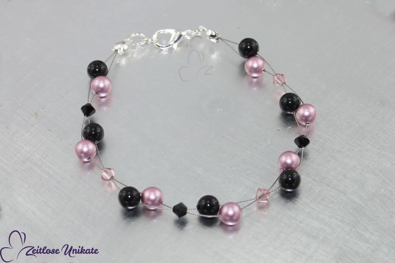 Vintage rosa / schwarzes Armband dient als Beispiel für Armschmuck in dunkelgrau