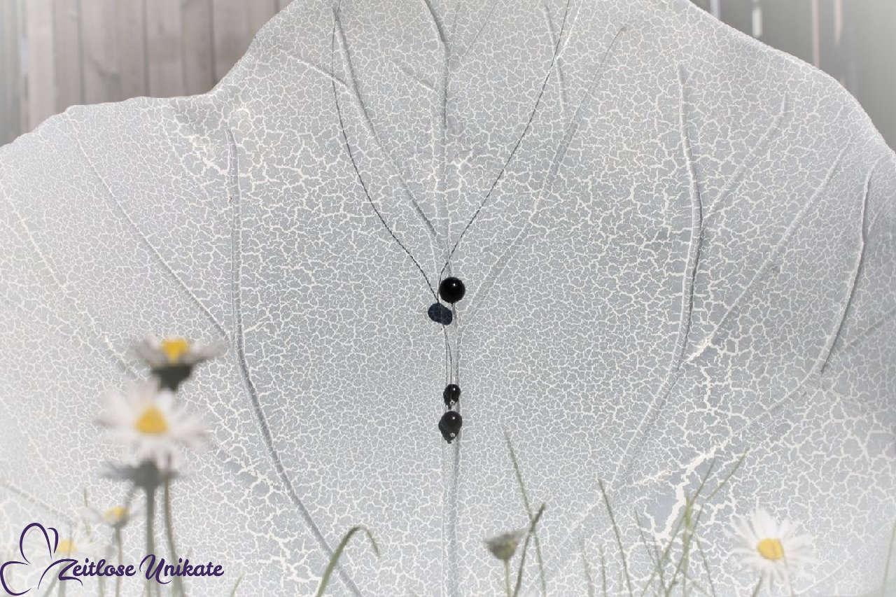 transparente Y-Kette - drei schwarze schwebende Perlen
