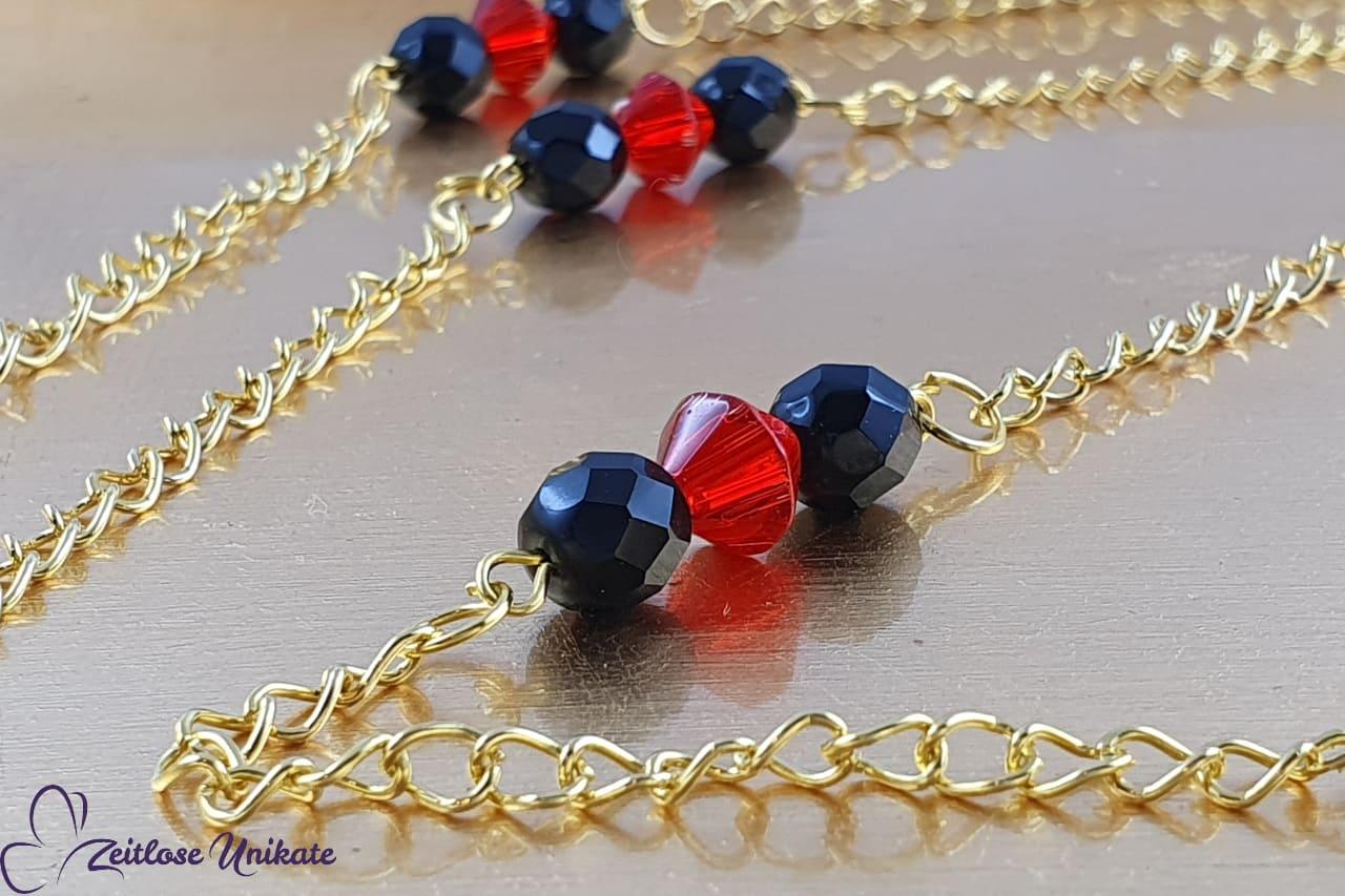Brillenkette goldfarben und rot, schlicht und elegant